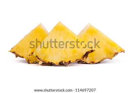 Pieces  of pineapples isolated on a white background - stock photo