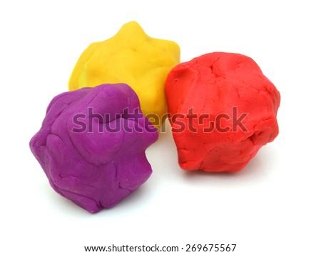 pieces of plasticine on white background - stock photo