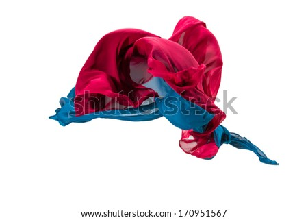 pieces of  red and blue fabric flying, high-speed studio shot - stock photo