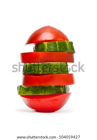 Pieces of tomato and cucumber isolated on white - stock photo