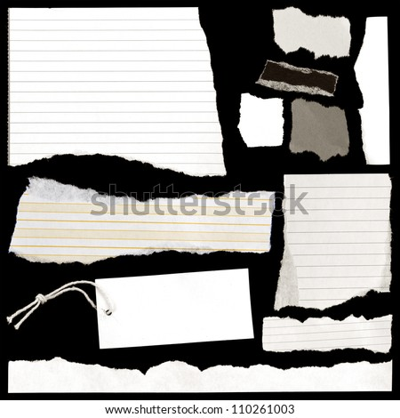 Pieces of torn paper and luggage tag on black. - stock photo
