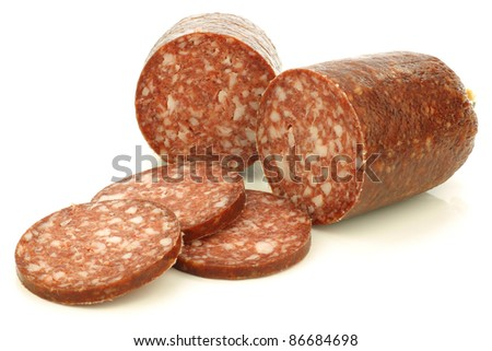 "pieces of traditional dutch sausage called ""boerenmetworst"" on a white background - stock photo"
