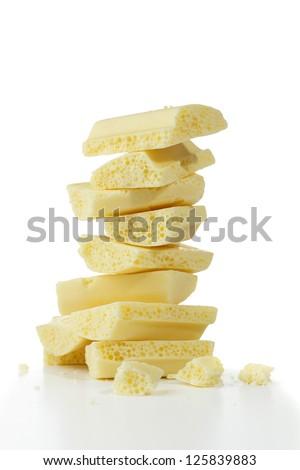 Pieces of white porous chocolate - stock photo