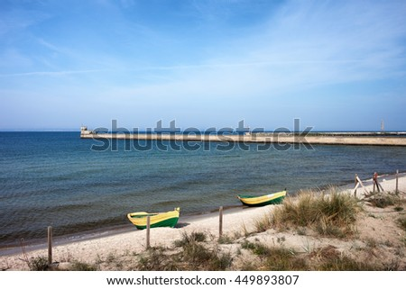 Pier and beach with boats in Hel, resort town on Hel Peninsula at Baltic Sea and Puck Bay in Poland - stock photo