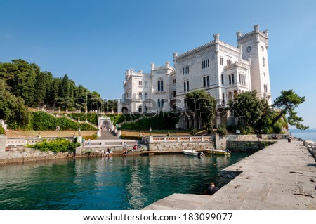 Pier and little port at Miramare castle in Italy - stock photo