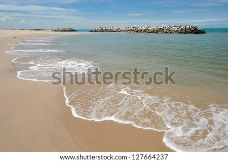 Pier/Breakwater at Rayong beach, Thailand. - stock photo