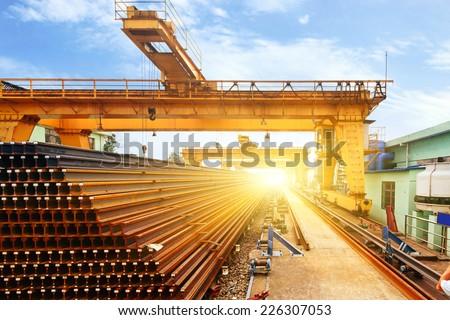 Pier bridge crane and cargo handling, cargo trains transported away. - stock photo