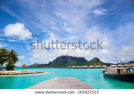 Pier in Bora Bora island.  Dock with a boat.  Paradise honeymoon destination. - stock photo