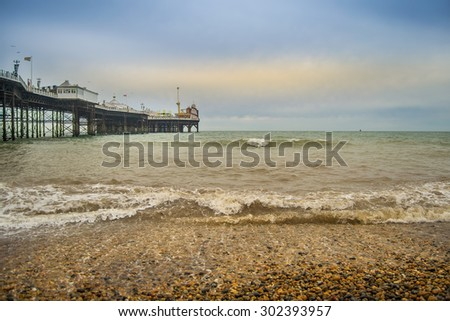 Pier in Brighton, south England during sunset. - stock photo