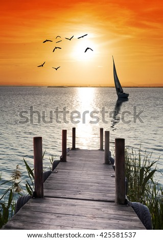 pier in the lake - stock photo