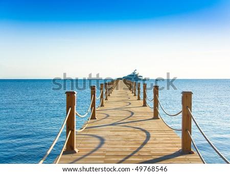 Pier into ocean - stock photo