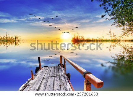Pier on Lake colors - stock photo
