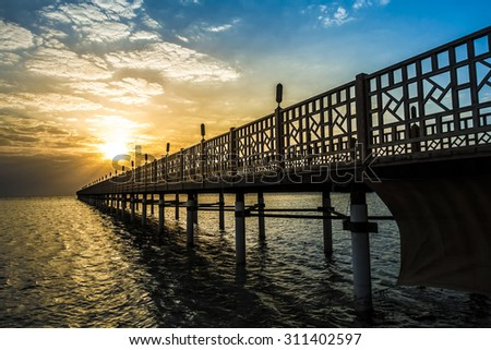 Pier on Red Sea in Hurghada/Makadi Bay at sunrise, Egypt - stock photo
