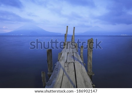 Pier on the Atitlan Lake in Guatemala at night - stock photo