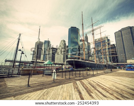 Pier South Street Seaport and Manhattan Skyline in New York City, USA, vintage style - stock photo