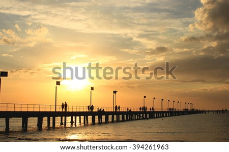 Pier, sunset, clouds and silhouettes, Frankston, Victoria, Australia - stock photo