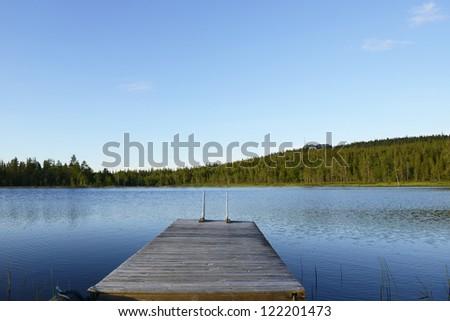 Pier to the lake - stock photo