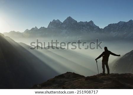 Pierced by the light. Nepal, Himalaya. Sagarmatha National Park, Everest region. - stock photo