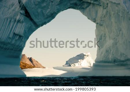 Pierced Iceberg - Scoresby Sound - Greenland - stock photo