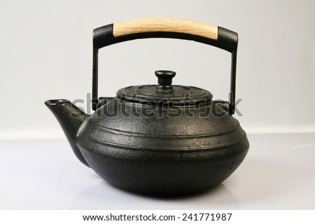 Pig-iron teapot it is isolated on a white background - stock photo