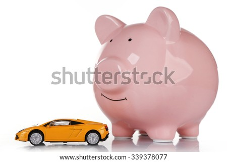 Pig moneybox and toy car isolated on white - stock photo