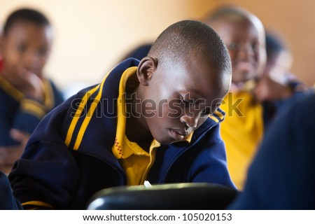 PIGGS PEAK, SWAZILAND-JULY 29: Unidentified orphan schoolboys on July 29, 2008 in Nazarene Mission School, Piggs Peak, Swaziland. Close to 10% of Swazilands population are orphans, due to HIV/AIDS. - stock photo