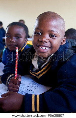 PIGGS PEAK, SWAZILAND-JULY 29: Unidentified Swazi schoolboys on July 29, 2008 in Nazarene Mission School, Piggs Peak, Swaziland. Close to 10% of Swaziland's population are orphans, due to HIV/AIDS. - stock photo