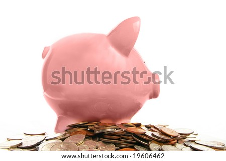 piggy bank and assorted coins, on white - stock photo