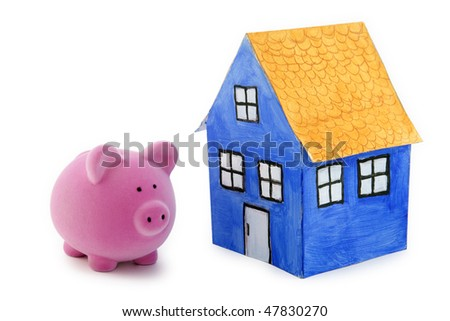Piggy bank and blue paper house with clipping path - stock photo