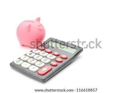 piggy bank and calculator - stock photo