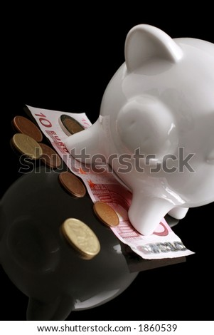 piggy bank and euros on reflective background - stock photo