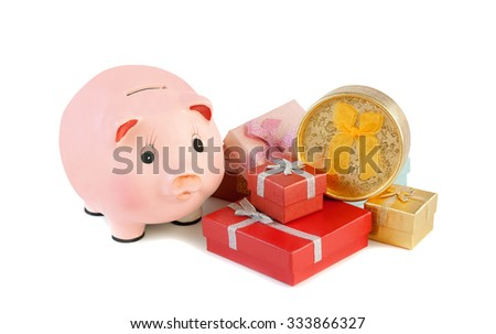 Piggy bank  and gift boxes isolated on a white background. - stock photo