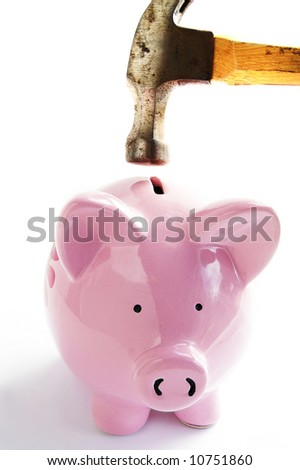Piggy bank and hammer closeup on white - stock photo