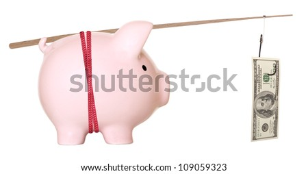 Piggy bank and hundred dollars on fishing hook - stock photo
