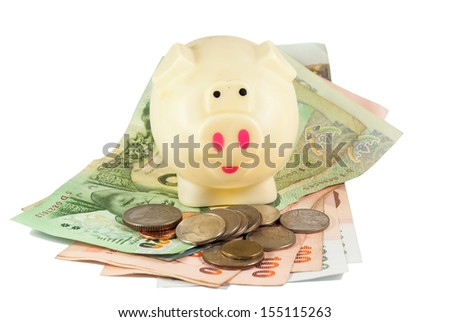 Piggy bank and money isolated on white background - stock photo