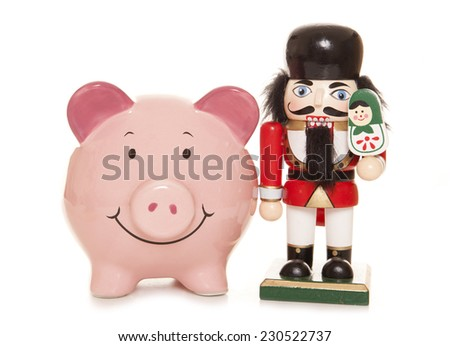 piggy bank and nutcracker christmas ornament cutout - stock photo