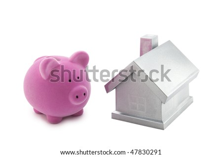 Piggy bank and silver house with clipping path - stock photo