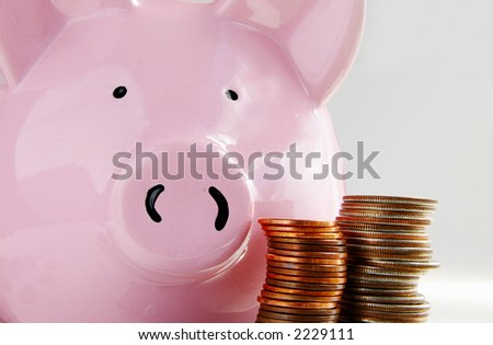 Piggy bank and stacked coins - stock photo