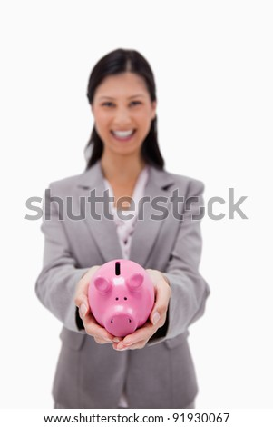 Piggy bank being held by businesswoman against a white background - stock photo