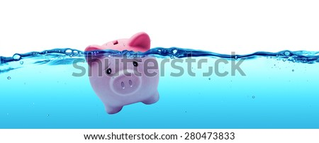 Piggy bank drowning in debt - savings to risk  - stock photo