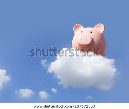 Piggy bank flying free in sky with cloud, concept for business and cloud computing - stock photo