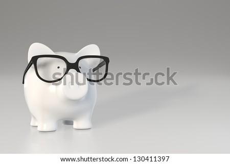 Piggy bank - glasses - stock photo