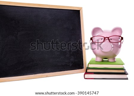 Piggy bank, glasses, save money for college education concept - stock photo