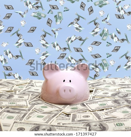 Piggy bank in a pile of dollars - stock photo
