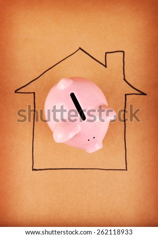Piggy Bank in House - stock photo