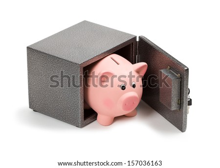 Piggy bank in safe. Bank safe is better than keeping money at home concept. - stock photo
