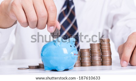 Piggy bank officer put money inside for invest in the future - stock photo