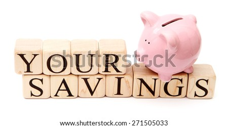 Piggy Bank on white background with blocks spelling out your savings - stock photo