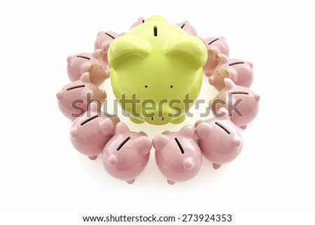 Piggy Bank on White Background with small piggy banks all around - stock photo
