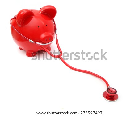 Piggy Bank on White Background with stethescope - stock photo